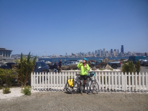 Cyclist drinking water in West Seattle
